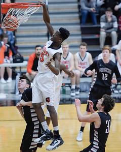 McHenry senior Matthew Mohr dunks the basketball during a game against Prairie Ridge on Friday, February 3, 2017. McHenry won 53-51.