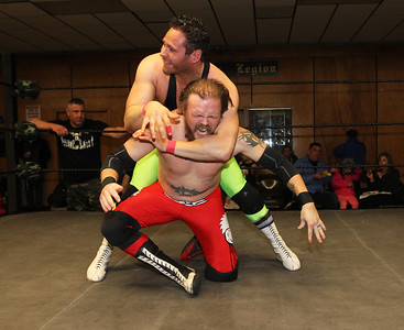 Candace H. Johnson-For Shaw Media Jeff Luxon takes control against Chase McCoy during POWW Entertainment's Live Pro Wrestling at the American Legion in Fox Lake.