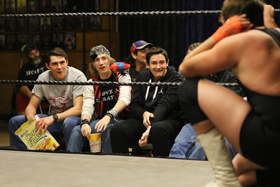 Candace H. Johnson-For Shaw Media Brett Huizinga, 17, of Island Lake, John Eccles, 18, of Wauconda and Danny Fallon, 14, of Arlington Heights watch POWW Entertainment's Live Pro Wrestling at the American Legion in Fox Lake.