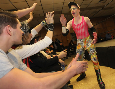 Candace H. Johnson-For Shaw Media Mason the wrestler greets fans before his Bedazzled Tag Team match during POWW Entertainment's Live Pro Wrestling at the American Legion in Fox Lake.