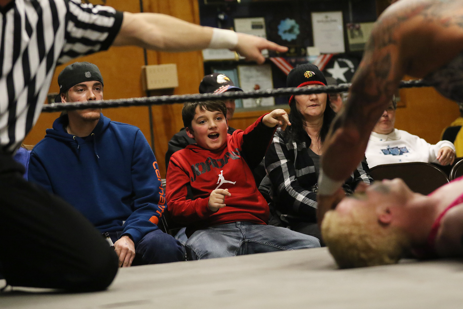 Candace H. Johnson-For Shaw Media Joseph Ricchio, 10, of Wauconda (center) points to Mason on the mat as he wrestles Hardcore Craig during POWW Entertainment's Live Pro Wrestling at the American Legion in Fox Lake.