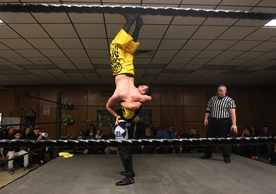 Candace H. Johnson-For Shaw Media Scotty D picks up Huevos de Oros and gets ready to throw him as they wrestle during POWW Entertainment's Live Pro Wrestling at the American Legion in Fox Lake.