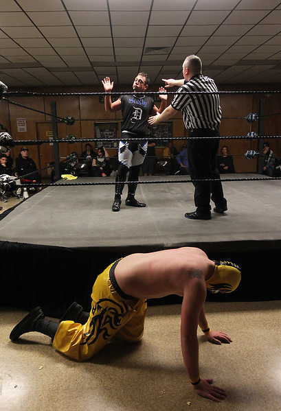 Candace H. Johnson-For Shaw Media Scotty D explains himself to the referee as his opponent, Huevos de Oros, falls out of the ring as they wrestle during POWW Entertainment's Live Pro Wrestling at the American Legion in Fox Lake.