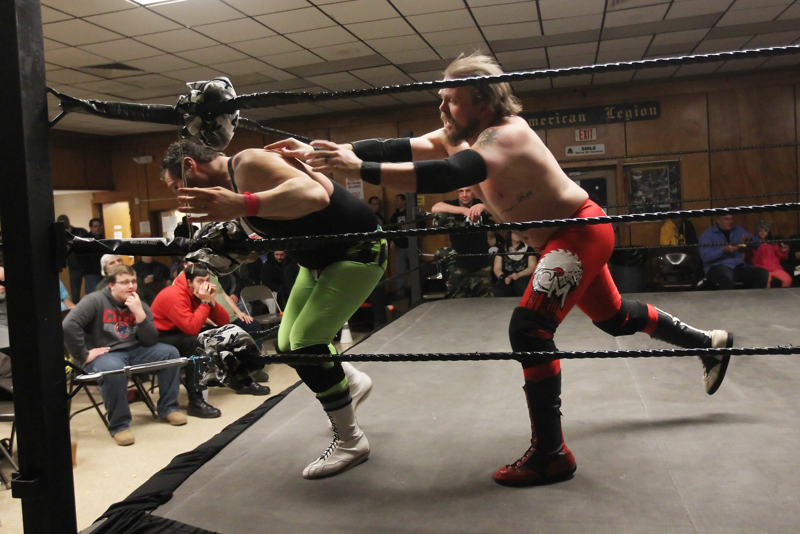 Candace H. Johnson-For Shaw Media Jeff Luxon escapes the grasp of Chase McCoy during POWW Entertainment's Live Pro Wrestling at the American Legion in Fox Lake.