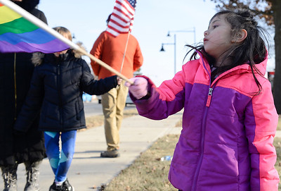 Alycianna De La Fuente (cq) waves a rainbow flag during a rally at McCormick Park on Sunday, Feb. 5, 2017. De La Fuente was at the rally with her family.
