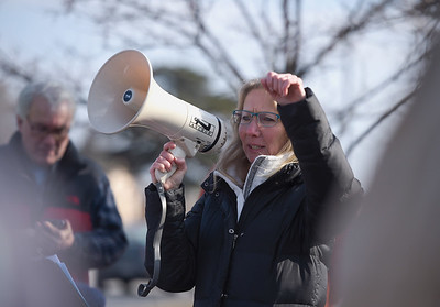 Jill Kuhns one of the organizers of the rally pumps up the crowd before a group of speakers shared ideas at McCormick Park on Sunday, Feb. 5, 2017.