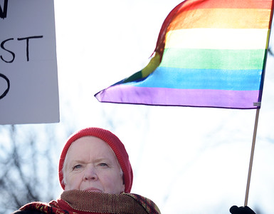 Twigg a local activist stands atop a park bench during a rally at McCormick Park on Sunday, Feb. 5, 2017. Twigg is a member of First Congregational Church and was very vocal at the rally.