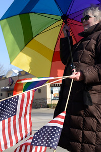Barbara Marian, of Harvard, is Catholic, attends a protest at McCormick Park on Sunday, Feb. 5, 2017, protesting Trump's anticipation of signing an executive order favoring religious freedom of the rights of LGBT people. Marian attended in support of the LGBT community because she has many family members that are gay.