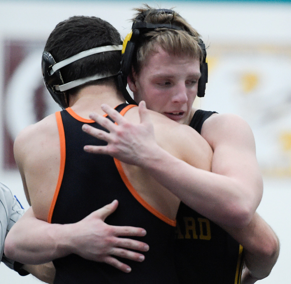 Marty Krasinski (cq) of Harvard, hugs opponent Frank Carone of Crystal Lake Central after a match at class 2A wrestling regional on Saturday, Feb. 4, 2017 at Woodstock North High School. Krasinski came from behind to win the match at the 160 pound weight class.