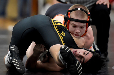 Brock Montford, top,  of Crystal Lake Central High School wrestles Uriel Herrera of Harvard High School at class 2A wrestling regionals on Saturday, Feb. 4, 2017 at Woodstock North High School. Montford won the 113 pound weight class.