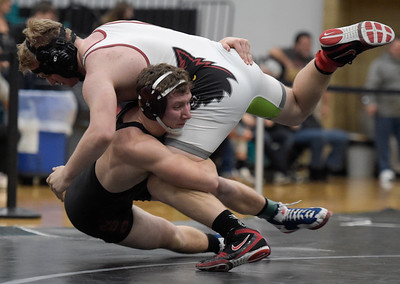 Joe Mier, bottom, of Marengo wrestles Nick Fretzner of Prairie Ridge during class 2A wrestling regional finals Saturday, Feb. 4, 2017 at Woodstock North High School. Mier won the 170 pound weight class.