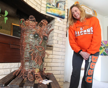 Candace H. Johnson Deb Trombino, of Antioch looks at her nephew's Logan Ghormley's wire sculpture titled, The Trunk Man, on display during the People's Choice Exhibition at the Antioch Fine Arts Foundation Art Gallery & Education Center on Route 83 in Antioch.