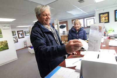 Candace H. Johnson-For Shaw Media George Schau, of Kenosha, Wis., casts his vote for his favorite 2D and 3D artwork with his wife, Betsy, beside  him during the People's Choice Exhibition at the Antioch Fine Arts Foundation Art Gallery & Education Center on Route 83 in Antioch.