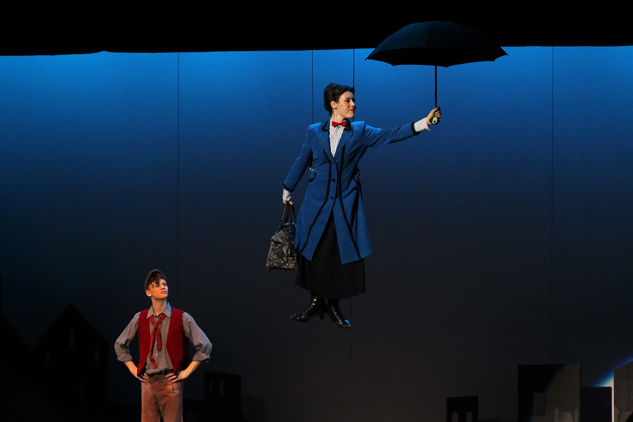 Candace H. Johnson-For Shaw Media Matthew Schroeder, of Gurnee as Bert, watches Anna Brown, of Fox Lake, as Mary Poppins,  both 17, fly with her umbrella off the stage during Spotlight Youth Theater's Mary Poppins at the College of Lake County in Grayslake.