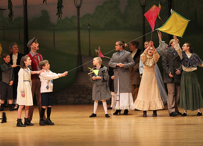 "Candace H. Johnson-For Shaw Media Abby Hough, 13, of Round Lake, as Jane Banks, Matthew Schroeder, 17, of Gurnee as Bert, and Joshua Zientara, 11, of Lake Villa as Michael Banks, sing, ""Let's Go Fly A Kite,"" during Spotlight Youth Theater's Mary Poppins at the College of Lake County in Grayslake."