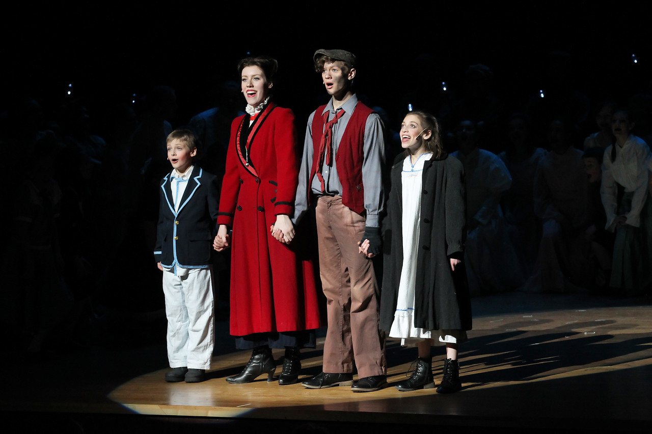 "Candace H. Johnson-For Shaw Media Joshua Zientara, 11, of Lake Villa, as Michael Banks; Anna Brown, of Fox Lake as Mary Poppins; Matthew Schroeder, of Gurnee, as Bert; both 17, and Abby Hough, 13, of Round Lake as Jane Banks sing, ""Anything Can Happen,"" in Act II during Spotlight Youth Theater's Mary Poppins at the College of Lake County in Grayslake."