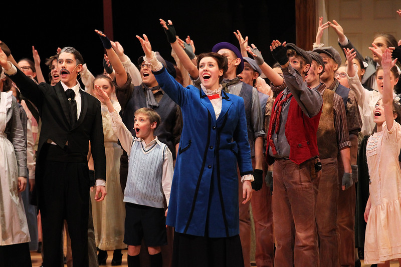 Candace H. Johnson-For Shaw Media Anna Brown, 17, of Fox Lake, as Mary Poppins (center) sings with the cast in the Finale during Spotlight Youth Theater's Mary Poppins at the College of Lake County in Grayslake.