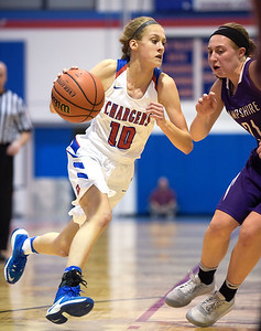 Dundee Crown freshman Katelyn Skibinski (cq) drive to the basket as Hampshire junior Lauren Hermann attempts to guard her during a conference game at Dundee Crown on Monday, Feb. 6, 2017. Dundee Crown won 49-44.