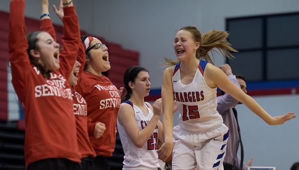 Dundee Crown freshman Cassidy Randl, far right, jumps and cheers after teammate Kennedy White, not pictures, sunk a 3-pointer during a game against Hampshire on Monday, Feb. 6, 2017. The Dundee Crown Chargers won 49-44.