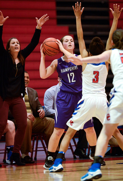 Hampshire senior Rachel Dumoulin looks to pass the ball as Dundee Crown Head Coach Sarah Miller yells to Kennedy White to keep her hands up during a conference game Monday, Feb. 6, 2017.  Dundee-Crown won 49-44.