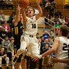 Kaneland's Rhett Espe goes up for the shot past Sterling's Reid Blackburn on Feb. 3 in Maple Park.