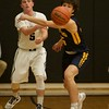 Kaneland's Jake Hed makes a pass past the defense of Sterling's Daniel Pontiac on Feb. 3 in Maple Park.