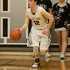 Kaneland's Mason Conroy dribbles up court against Sterling on Feb. 3 in Maple Park.