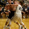 Kaneland's Blake Feiza (23) and Jake Hed (5) battle with Sterling's Ryan Blackburn for the jump ball on Feb. 3 in Maple Park.
