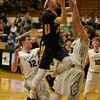 Sterling's Sean Gingrich goes up for the shot over Kaneland's Blake Feiza on Feb. 3 in Maple Park.