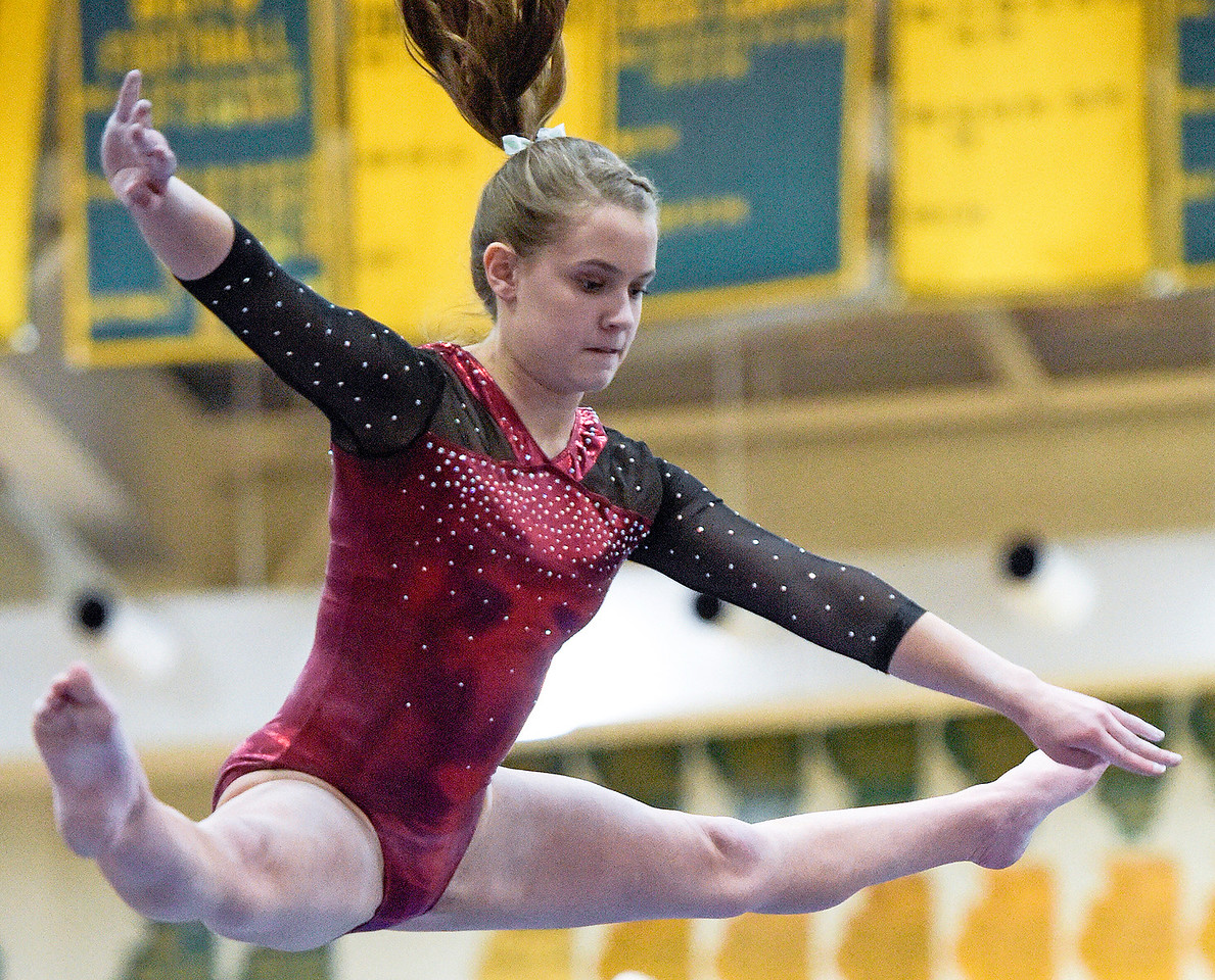 Prairie Ridge sophomore Clancy Raupp (cq) competes on the balance beam at the IHSA girls gymnastics sectional at Fremd High School on Tuesday, Feb. 7, 2017. Raupp scores an 8.35.