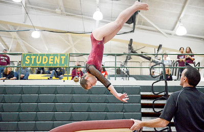 Prairie Ridge Nikki Baars competes on vault at the IHSA girls gymnastics sectional at Fremd High School on Tuesday, Feb. 7, 2017. Barrs (cq) won the all-around title as well as individual titles for vault, uneven bars, balance beam and floor.
