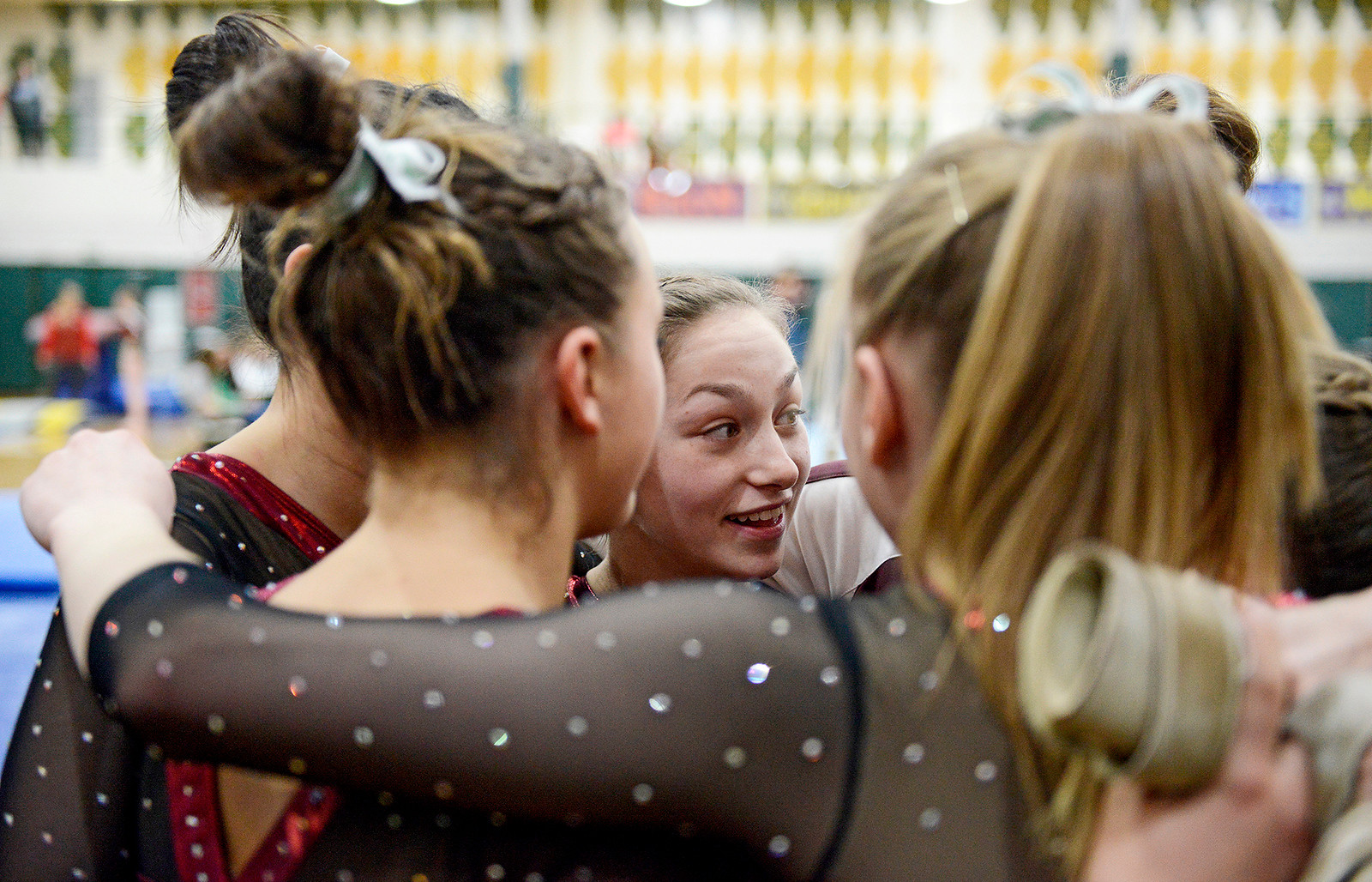 Prairie Ridge Nikki Barrs (cq), center, and her team talk about strategy for the balance beam prior to the third rotation at the IHSA girls gymnastics sectional at Fremd High School on Tuesday, Feb. 7, 2017. Barrs (cq) scored a 9.5 on balance beam.