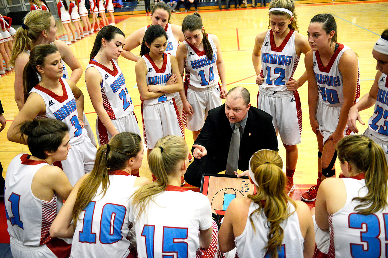 Kayla Wolf for Shaw Media– Marian Central Catholic Head Coach Tony Powe (cq) talks to his team Wednesday, Feb. 8, 2017, before a game against Benet Academy. Despite the Hurricane's loss 61 to 41, seniors on the team were able to play the last 60 seconds of the game.