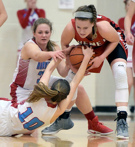 Kayla Wolf for Shaw Media– Marian Central Catholic's Grace Shukis, front, and Jacqueline Chmiel (cq) fight for the ball with Benet senior Katherine Jaseckas, Wednesday, Feb. 8, 2017, during the first half of the game. Marian Central Catholic lost 61-41.