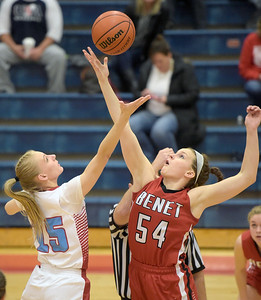 Kayla Wolf for Shaw Media– Marian Central Catholic senior Emily Radecki and Benet Academy senior Katherine Jaseckas reach for the jump ball Wednesday, Feb. 8, 2017. Jaseckas tipped the ball to a teammate.