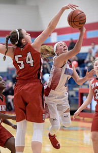Kayla Wolf for Shaw Media– Marian Central Catholic junior Vannessa Garrelts (cq) attempts to score Wednesday, Feb. 8, 2017, but is blocked by Benet Academy senior Katherine Jaseckas. Garrelts scored 20 points during the game.