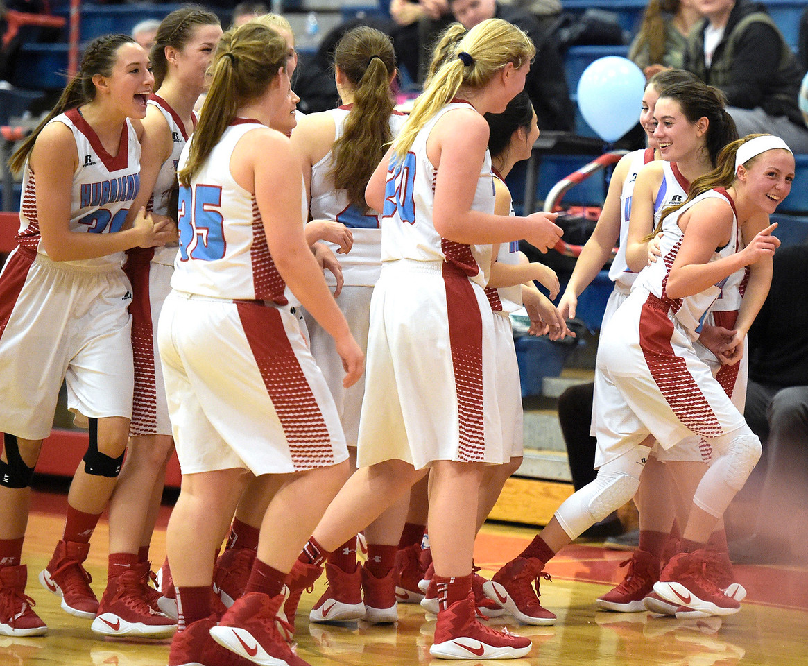 Kayla Wolf for Shaw Media– Marian Central Catholic junior Vannessa Garrelts (cq), right, celebrates with teammates Wednesday, Feb. 8, 2017, after scoring a buzzer beating 3-pointer at the end of the third quarter.