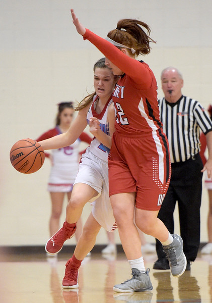 Kayla Wolf for Shaw Media– Marian Central Catholic senior Grace Shukis is guarded by Benet Academy sophomore Kendal Schramek Wednesday, Feb. 8, 2017, as she dribbles down the sideline. Marian Central Catholic lost 61-41.
