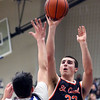 St. Charles East's Justin Hardy takes a shot during a game at Geneva on Feb. 10. The Saints lost 74-56.