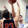 Geneva's Dominic Navigato gets an offensive rebound during a game against visiting St. Charles East on Feb. 10. The Vikings won 74-56.