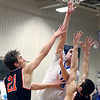 Geneva's Cole Navigato takes a shot during a game against visiting St. Charles East on Feb. 10. The Vikings won 74-56.