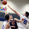 St. Charles East's Zach Mitchell takes a shot during a game at Geneva on Feb. 10. The Saints lost 74-56.
