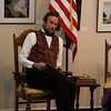 Abraham Lincoln, portrayed by Michael Krebs, reads during Meet the Lincolns at the Norris Cultural Arts Center on Feb. 5 in St. Charles.