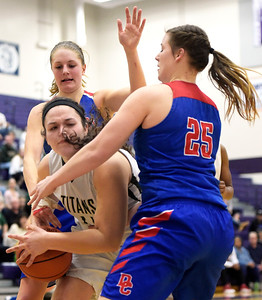 Dundee-Crown seniors Allison Michalski, right, and Paige Gieseke, back, fight for the ball Monday, Feb. 20, 2017, with Rockford Boylan senior Bridget Bishop during the class 4A sectional semifinal at Hampshire High School. Rockford Boylan won 47-37.