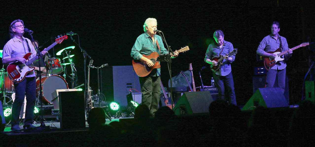"Candace H. Johnson-For Shaw Media Tom Carey, of Arlington Heights (center) lead singer with Heartache Tonight, a tribute to the Eagles, and his band sing, ""Tequila Sunrise,"" during their concert at the Round Lake Beach Cultural & Civic Center."