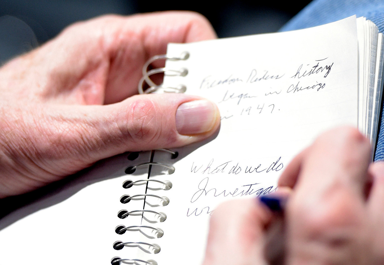 Dr. Jack Keehan takes notes during a speech given by civil rights activist and Freedom Rider Thomas Armstrong III Wednesday, Feb. 22, 2017, at the Algonquin Area Public Library. Armstrong spoke about his experiences growing up in Mississippi and being a Freedom Rider.