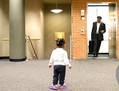 Sixteen-month-old Olivia McCoy runs to her great grandfather and civil rights activist Thomas Armstrong III as he exits the elevator Wednesday, Feb. 22, 2017, after speaking at the Algonquin Area Public Library. Armstrong co-authored his book titled Autobiography of a Freedom Rider: My Life as a Foot Soldier for Civil Rights, with Natalie Bell.