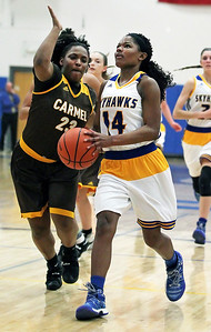Candace H. Johnson-For Shaw Media Johnsburg's Danielle McCauley (on right) looks up for a shot against Carmel's Ranya Jamison in the second quarter during the Class 3A sectional semifinal game at Johnsburg High School.