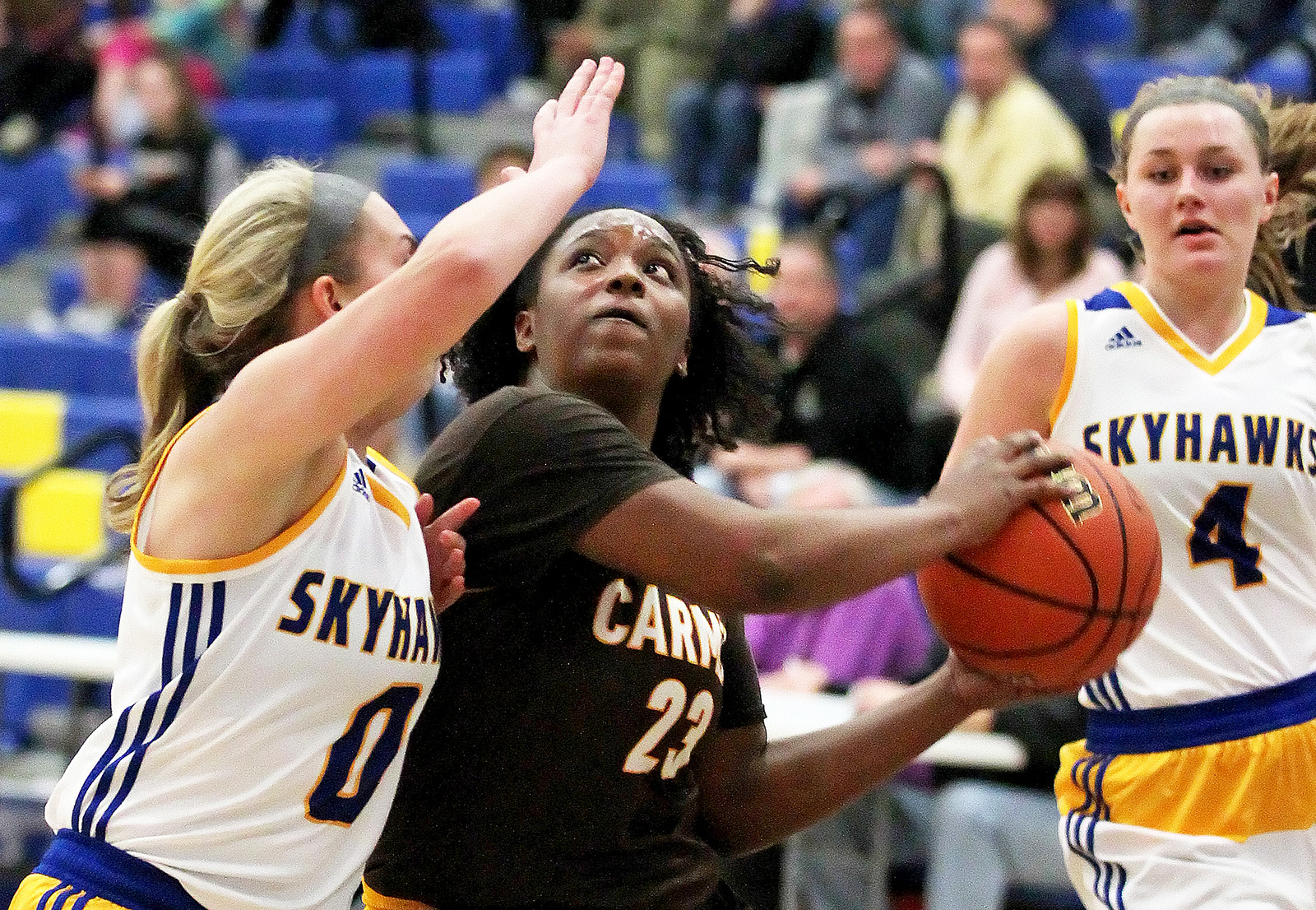 Candace H. Johnson-For Shaw Media Carmel's Ranya Jamison looks up for a shot against Johnsburg's Taylor Piggot in the third quarter during the Class 3A sectional semifinal game at Johnsburg High School.
