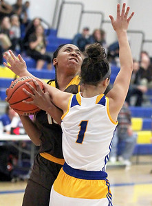 Candace H. Johnson-For Shaw Media Carmel's Daija Pruitt shoots past the block by Johnsburg's Ava Interrante in the first quarter during the Class 3A sectional semifinal game at Johnsburg High School.